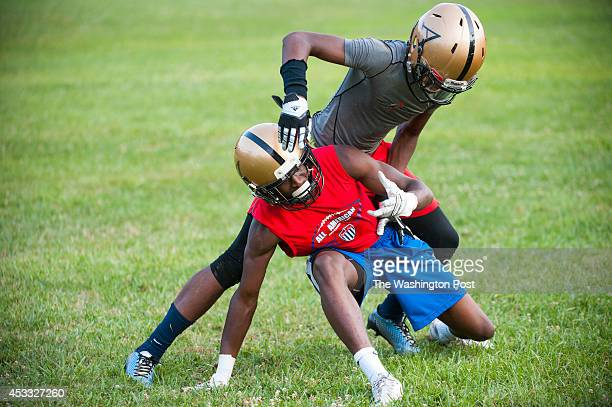 Trevon Diggs and Grant Ibeh untangle as they went full speed for the pass during Avalon's practice August 5 2014 in Gaithersburg MD