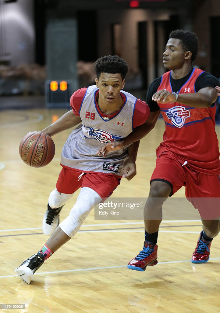 Trevon Duval #28 in white drives to the hoop during the NBPA Top 100 Camp on June 19, 2015 at John Paul Jones Arena in Charlottesville, Virginia.