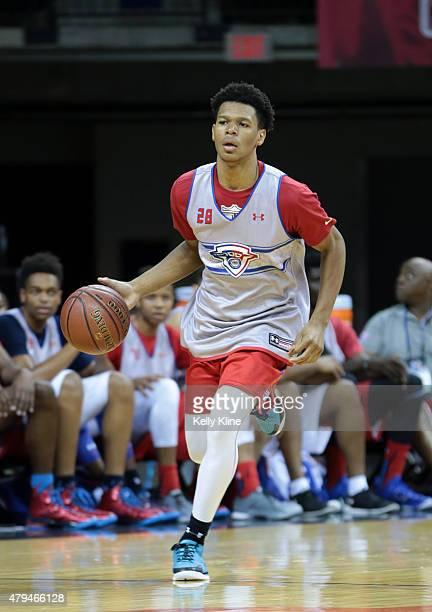 Trevon Duval in white drives to the hoop during the NBPA Top 100 Camp on June 18 2015 at John Paul Jones Arena in Charlottesville Virginia