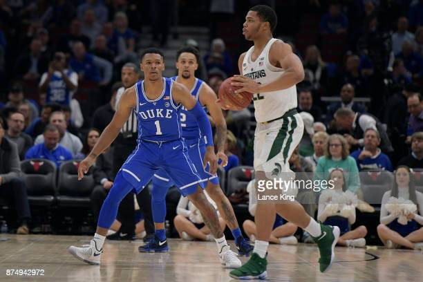 Trevon Duval of the Duke Blue Devils defends against Miles Bridges of the Michigan State Spartans during the Champions Classic at United Center on...
