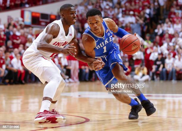 Trevon Duval of the Duke Blue Devils dribbles the ball around Josh Newkirk of the Indiana Hoosiers at Assembly Hall on November 29 2017 in...