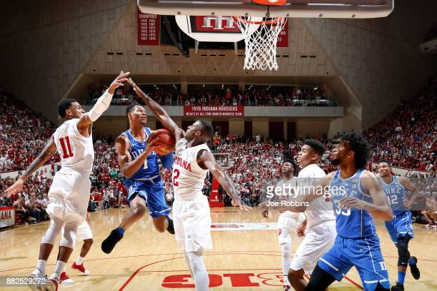 Trevon Duval of the Duke Blue Devils drives to the basket against Josh Newkirk and Devonte Green of the Indiana Hoosiers in the first half of a game...
