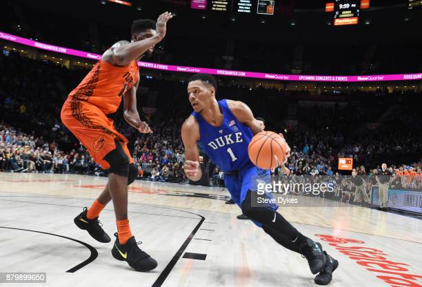 Trevon Duval of the Duke Blue Devils drives to the basket on Kevarrius Hayes of the Florida Gators in the second half of the game during the PK80Phil...