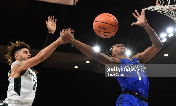 Trevon Duval of the Duke Blue Devils is fouled by Holland Woods of the Portland State Vikings during the second half of the game at the Veterans...