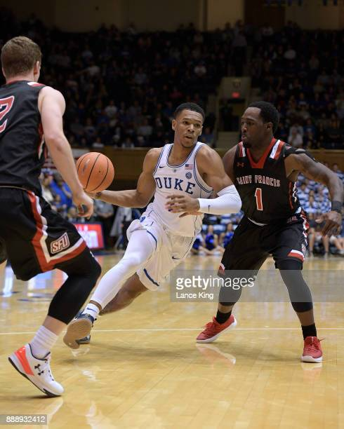 Trevon Duval of the Duke Blue Devils moves the ball against Malik Harmon of the St Francis Red Flash at Cameron Indoor Stadium on December 5 2017 in...