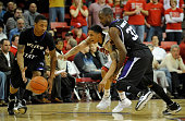 Tre'Von Willis of the UNLV Rebels goes for a steal between Damian Lillard and Matt Washington of the Weber State Wildcats during their game at the...