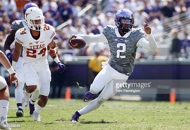 Trevone Boykin of the TCU Horned Frogs carries the ball against John Bonney of the Texas Longhorns in the third quarter at Amon G Carter Stadium on...