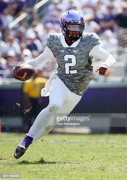 Trevone Boykin of the TCU Horned Frogs scrambles with the ball against the Texas Longhorns in the third quarter at Amon G Carter Stadium on October 3...