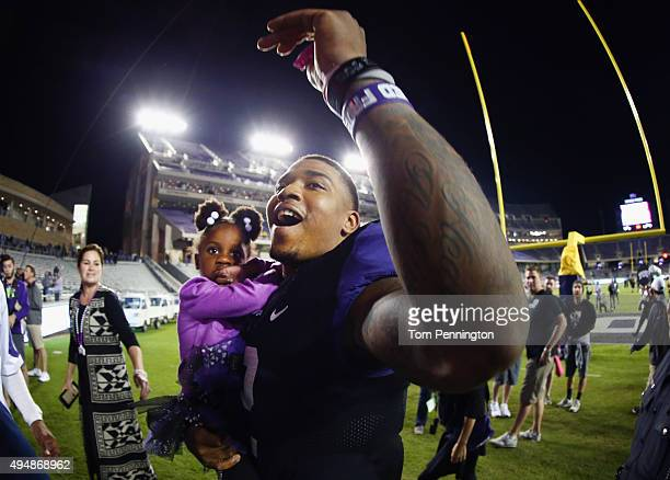 Trevone Boykin of the TCU Horned Frogs walks off the field with his sister Makayla Mosley after the Horned Frogs beat the West Virginia Mountaineers...
