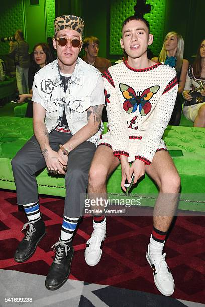 Trevor Andrew and Olly Alexander attend the Gucci show during Milan Men's Fashion Week SS17 on June 20 2016 in Milan Italy