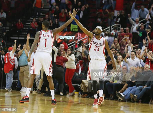 Trevor Ariza and Corey Brewer of the Houston Rockets celebrate after Brewer hit a threepoint shot near the end of the fourth quarter against the...