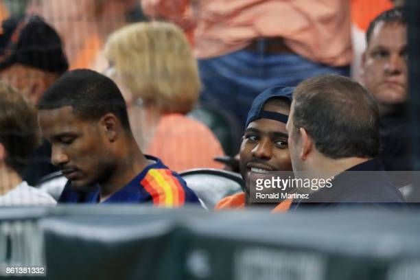 Trevor Ariza Chris Paul of the Houston Rockets and Rockets owner Tilman Fertitta attend game two of the American League Championship Series between...