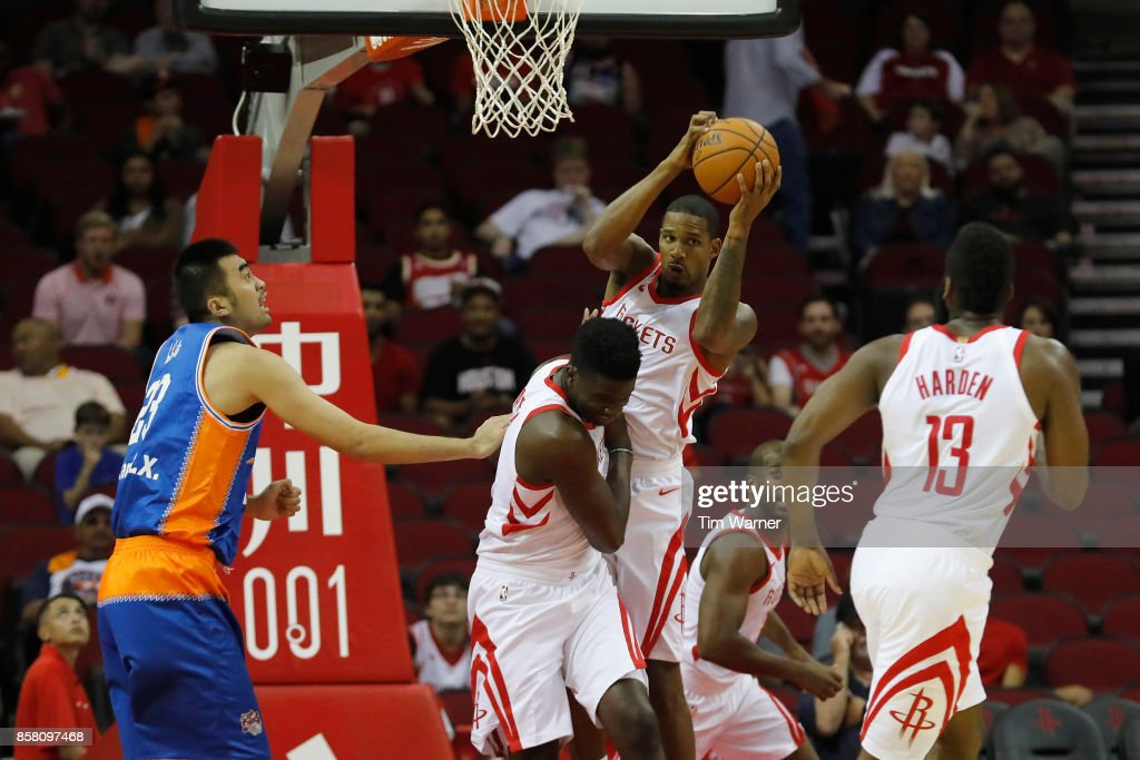 Trevor Ariza #1 of Houston Rockets grabs a rebound in the first half against the Shanghai Sharks at Toyota Center on October 5, 2017 in Houston, Texas.