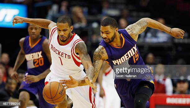 Trevor Ariza of the Houston Rockets and Marcus Morris of the Phoenix Suns battle for a loose basketball during their game at the Toyota Center on...