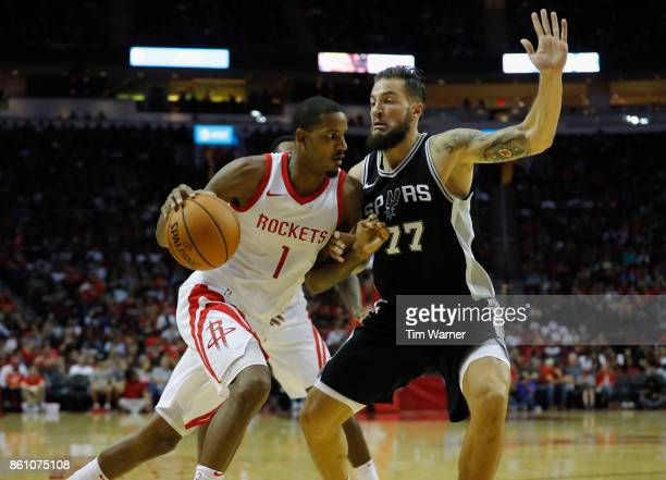 Trevor Ariza of the Houston Rockets drives the ball to the basket defended by Joffrey Lauvergne of the San Antonio Spurs in the second half at Toyota...
