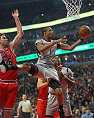 Trevor Ariza of the Houston Rockets goes up for a shot past Pau Gasol of the Chicago Bulls at the United Center on March 5 2016 in Chicago Illinois...