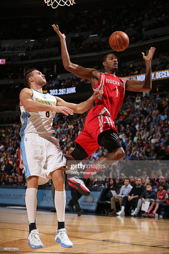 Trevor Ariza #1 of the Houston Rockets is fouled by Danilo Gallinari #8 of the Denver Nuggets as he goes up for a shot at Pepsi Center on November 13, 2015 in Denver, Colorado.