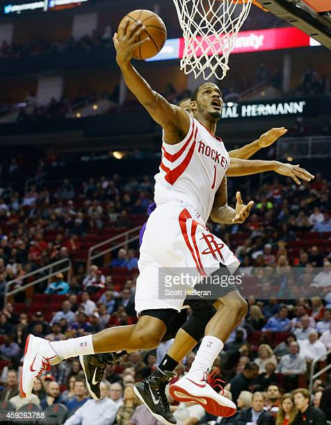 Trevor Ariza of the Houston Rockets takes a shot over Wesley Johnson of the Los Angeles Lakers during their game at the Toyota Center on November 19...