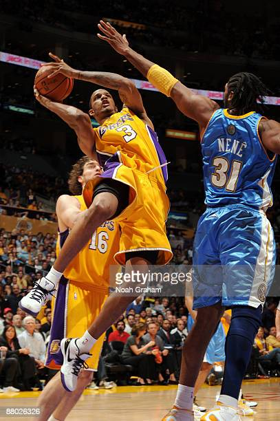 Trevor Ariza of the Los Angeles Lakers goes to the basket against Nene of the Denver Nuggets in Game Five of the Western Conference Finals during the...