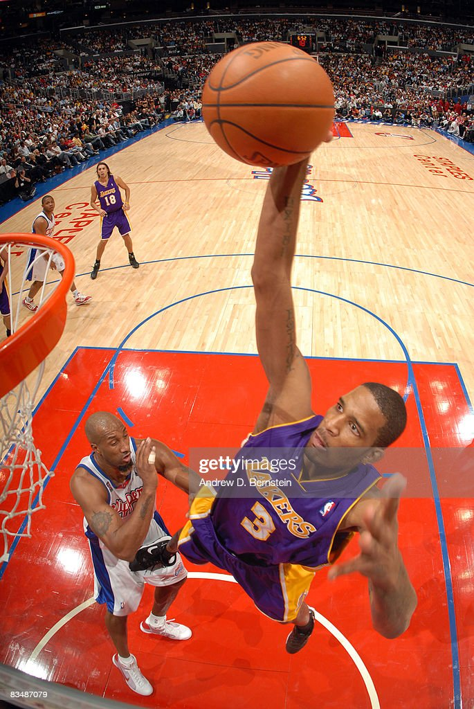 Trevor Ariza #3 of the Los Angeles Lakers goes up for a dunk over Brian Skinner #8 of the Los Angeles Clippers at Staples Center on October 29, 2008 in Los Angeles, California.
