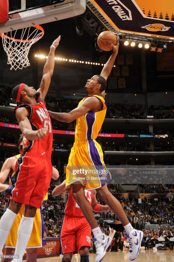 Trevor Ariza #3 of the Los Angeles Lakers rises for a dunk against Sean Williams #51 of the New Jersey Nets at Staples Center on November 25, 2008 in Los Angeles, California.