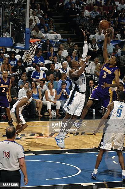 Trevor Ariza of the Los Angeles Lakers shoots against Dwight Howard of the Orlando Magic during Game Three of the 2009 NBA Finals at Amway Arena on...