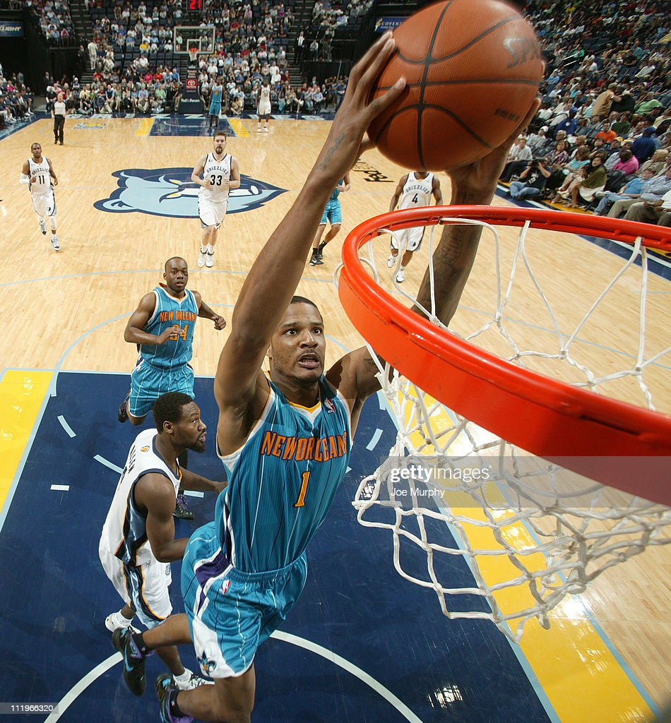 <a gi-track='captionPersonalityLinkClicked' href=/galleries/search?phrase=Trevor+Ariza&family=editorial&specificpeople=201708 ng-click='$event.stopPropagation()'>Trevor Ariza</a> #1 of the New Orleans Hornets dunks against the Memphis Grizzlies during the game on April 10, 2011 at FedExForum in Memphis, Tennessee.