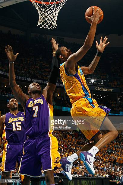 Trevor Ariza of the New Orleans Hornets shoots the ball over Lamar Odom of the Los Angeles Lakers in Game Three of the Western Conference...