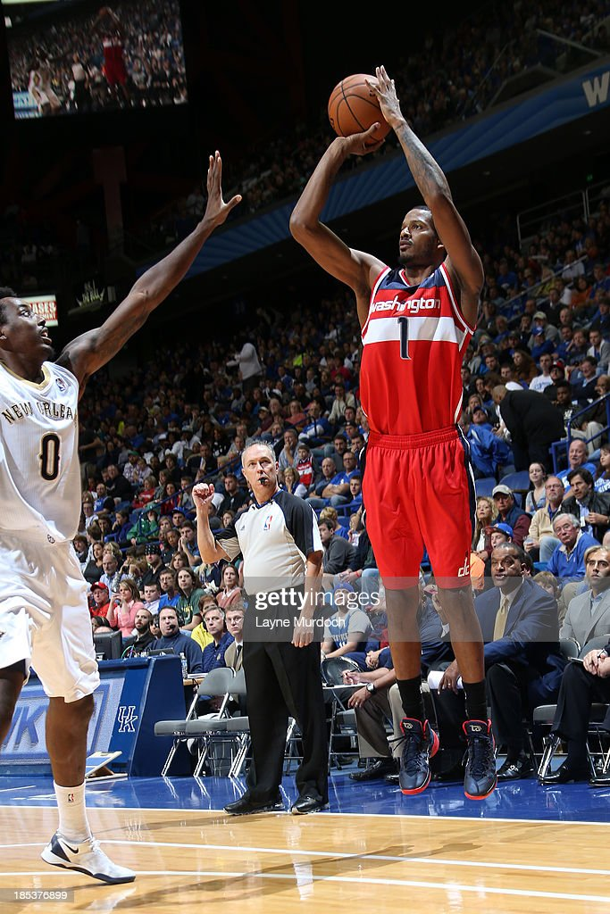 <a gi-track='captionPersonalityLinkClicked' href=/galleries/search?phrase=Trevor+Ariza&family=editorial&specificpeople=201708 ng-click='$event.stopPropagation()'>Trevor Ariza</a> #1 of the Washington Wizards attempts a 3-pointer over <a gi-track='captionPersonalityLinkClicked' href=/galleries/search?phrase=Al-Farouq+Aminu&family=editorial&specificpeople=5042446 ng-click='$event.stopPropagation()'>Al-Farouq Aminu</a> #0 of the New Orleans Pelicans during an NBA game on October 19, 2013 at Rupp Arena in Lexington, Kentucky.