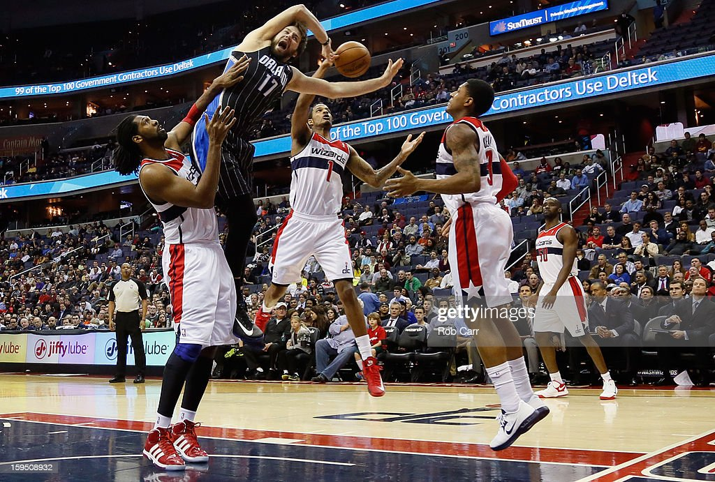 Trevor Ariza #1 of the Washington Wizards blocks a shot by Josh McRoberts #17 of the Orlando Magic as Nenê #42 (L) and Bradley Beal #3 of the Wizards look on during the first half at Verizon Center on January 14, 2013 in Washington, DC.