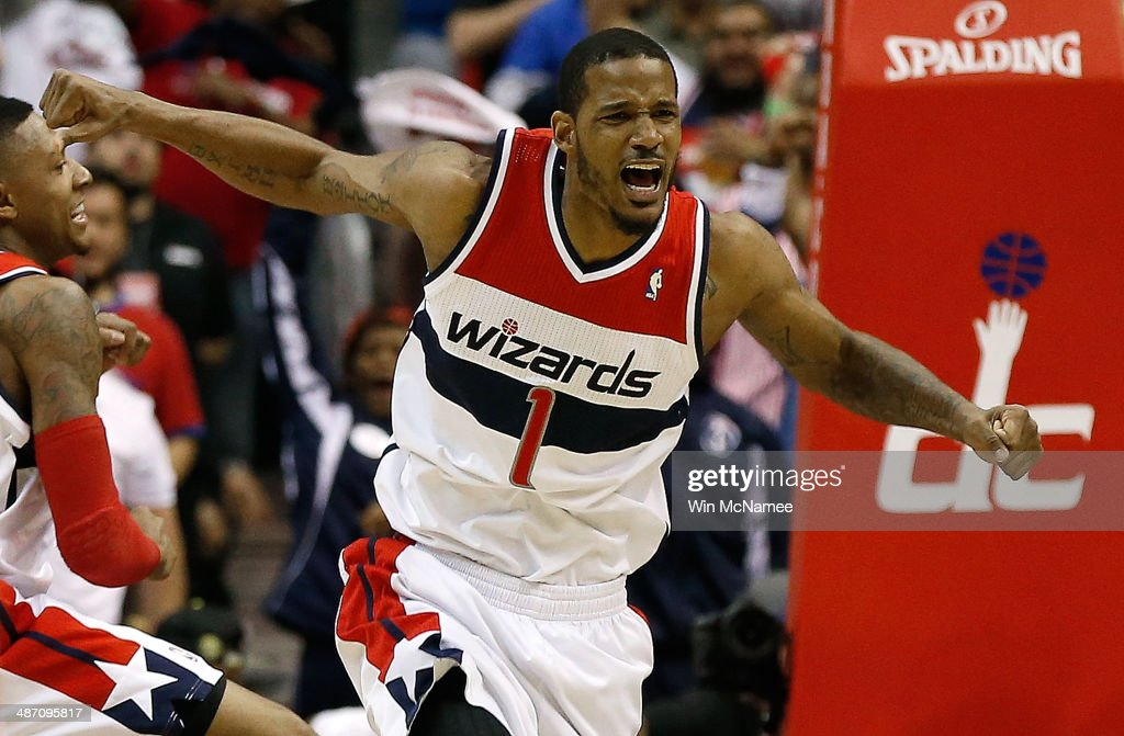 <a gi-track='captionPersonalityLinkClicked' href=/galleries/search?phrase=Trevor+Ariza&family=editorial&specificpeople=201708 ng-click='$event.stopPropagation()'>Trevor Ariza</a> #1 of the Washington Wizards celebrates after scoring a key basket late in the fourth quarter against the Chicago Bulls in Game Four of the Eastern Conference Quarterfinals during the 2014 NBA Playoffs at the Verizon Center on April 27, 2014 in Washington, DC. Washington won the game 98-89.