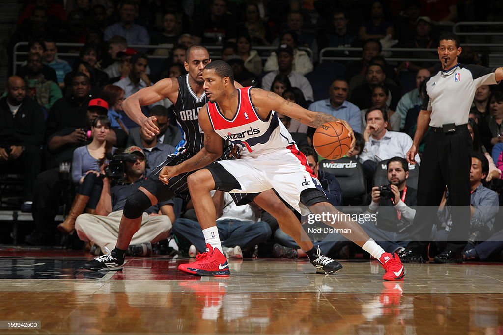 <a gi-track='captionPersonalityLinkClicked' href=/galleries/search?phrase=Trevor+Ariza&family=editorial&specificpeople=201708 ng-click='$event.stopPropagation()'>Trevor Ariza</a> #1 of the Washington Wizards drives against <a gi-track='captionPersonalityLinkClicked' href=/galleries/search?phrase=Arron+Afflalo&family=editorial&specificpeople=640861 ng-click='$event.stopPropagation()'>Arron Afflalo</a> #4 of the Orlando Magic during the game at the Verizon Center on January 14, 2013 in Washington, DC.
