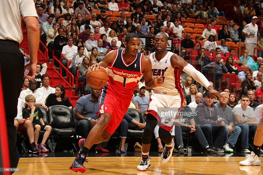<a gi-track='captionPersonalityLinkClicked' href=/galleries/search?phrase=Trevor+Ariza&family=editorial&specificpeople=201708 ng-click='$event.stopPropagation()'>Trevor Ariza</a> #1 of the Washington Wizards drives against <a gi-track='captionPersonalityLinkClicked' href=/galleries/search?phrase=Dwyane+Wade&family=editorial&specificpeople=201481 ng-click='$event.stopPropagation()'>Dwyane Wade</a> #3 of the Miami Heat on November 3, 2013 at American Airlines Arena in Miami, Florida.