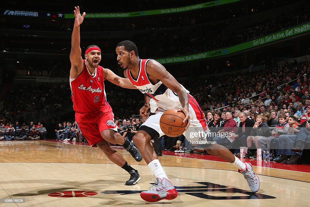 <a gi-track='captionPersonalityLinkClicked' href=/galleries/search?phrase=Trevor+Ariza&family=editorial&specificpeople=201708 ng-click='$event.stopPropagation()'>Trevor Ariza</a> #1 of the Washington Wizards drives against Jared Dudley #9 of the Los Angeles Clippers during the game at the Verizon Center on December 14, 2013 in Washington, DC.