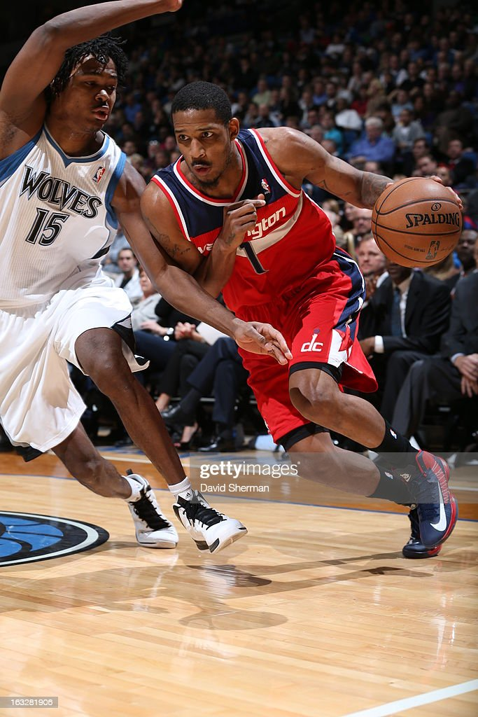 Trevor Ariza #1 of the Washington Wizards drives against Mickael Gelabale #15 of the Minnesota Timberwolves on March 6, 2013 at Target Center in Minneapolis, Minnesota.