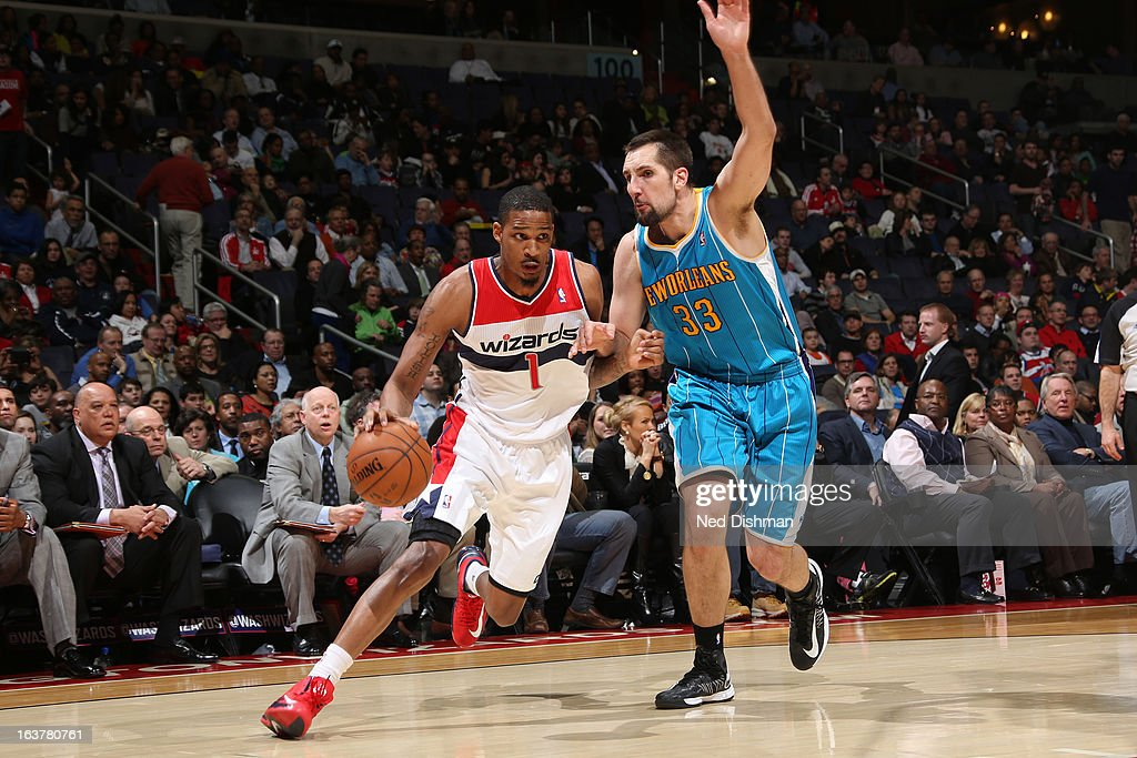 <a gi-track='captionPersonalityLinkClicked' href=/galleries/search?phrase=Trevor+Ariza&family=editorial&specificpeople=201708 ng-click='$event.stopPropagation()'>Trevor Ariza</a> #1 of the Washington Wizards drives against Ryan Anderson #33 of the New Orleans Hornets during the game at the Verizon Center on March 15, 2013 in Washington, DC.