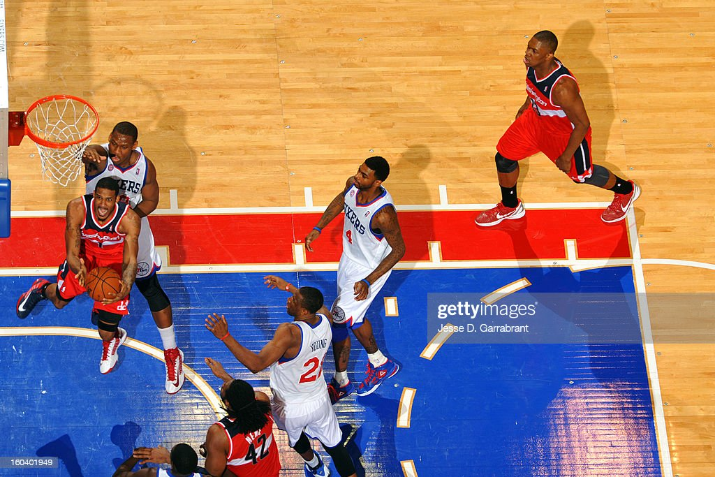 <a gi-track='captionPersonalityLinkClicked' href=/galleries/search?phrase=Trevor+Ariza&family=editorial&specificpeople=201708 ng-click='$event.stopPropagation()'>Trevor Ariza</a> #1 of the Washington Wizards drives to the basket against <a gi-track='captionPersonalityLinkClicked' href=/galleries/search?phrase=Lavoy+Allen&family=editorial&specificpeople=4628334 ng-click='$event.stopPropagation()'>Lavoy Allen</a> #50 of the Philadelphia 76ers at the Wells Fargo Center on January 30, 2013 in Philadelphia, Pennsylvania.