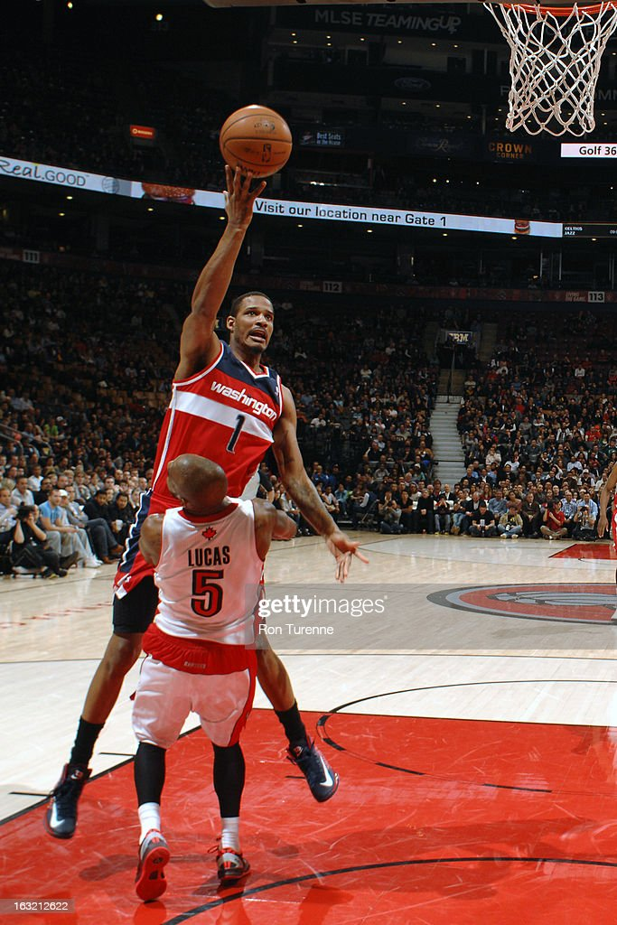 <a gi-track='captionPersonalityLinkClicked' href=/galleries/search?phrase=Trevor+Ariza&family=editorial&specificpeople=201708 ng-click='$event.stopPropagation()'>Trevor Ariza</a> #1 of the Washington Wizards drives to the basket against the Toronto Raptors on February 25, 2013 at the Air Canada Centre in Toronto, Ontario, Canada.