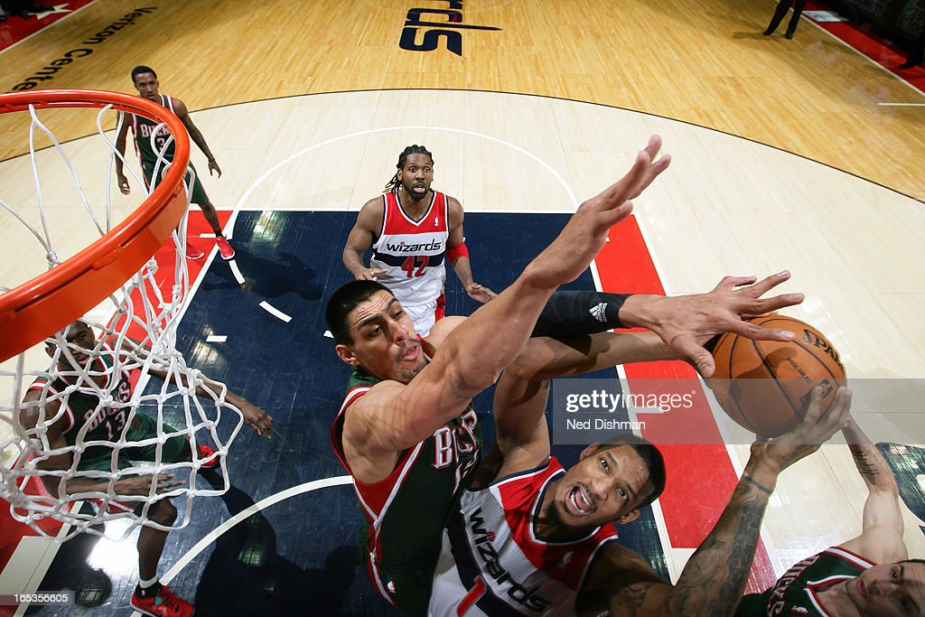 <a gi-track='captionPersonalityLinkClicked' href=/galleries/search?phrase=Trevor+Ariza&family=editorial&specificpeople=201708 ng-click='$event.stopPropagation()'>Trevor Ariza</a> #1 of the Washington Wizards drives to the basket against the Milwaukee Bucks at the Verizon Center on March 13, 2013 in Washington, DC.