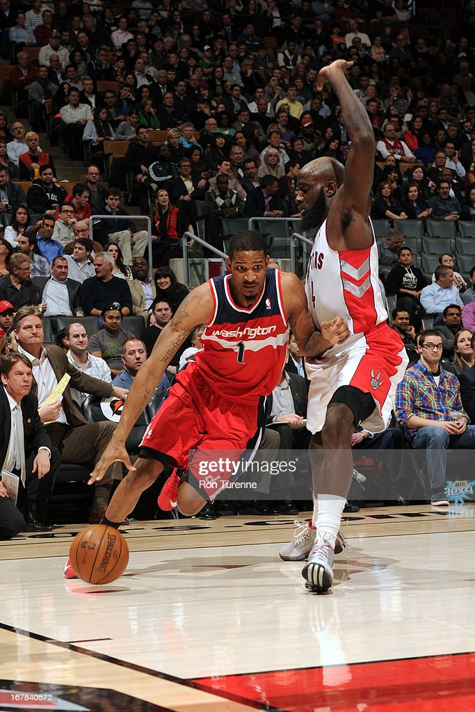 <a gi-track='captionPersonalityLinkClicked' href=/galleries/search?phrase=Trevor+Ariza&family=editorial&specificpeople=201708 ng-click='$event.stopPropagation()'>Trevor Ariza</a> #1 of the Washington Wizards drives to the basket against the Toronto Raptors on April 3, 2013 at the Air Canada Centre in Toronto, Ontario, Canada.