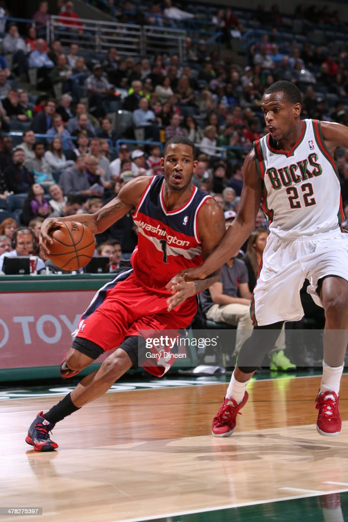 <a gi-track='captionPersonalityLinkClicked' href=/galleries/search?phrase=Trevor+Ariza&family=editorial&specificpeople=201708 ng-click='$event.stopPropagation()'>Trevor Ariza</a> #1 of the Washington Wizards drives to the basket against the Milwaukee Bucks on March 8, 2014 at the BMO Harris Bradley Center in Milwaukee, Wisconsin.