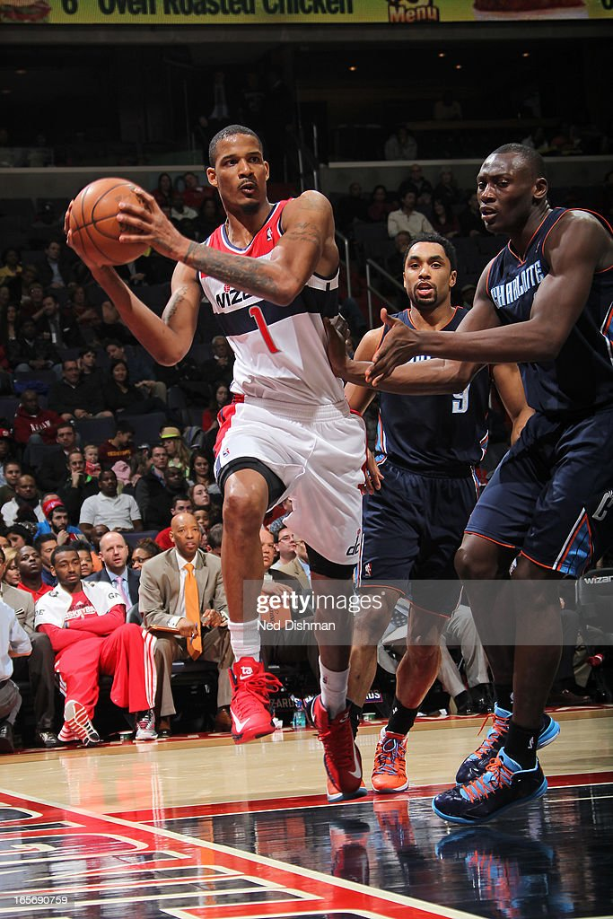 Trevor Ariza #1 of the Washington Wizards drives to the basket and passes the ball against the Charlotte Bobcats at the Verizon Center on March 9, 2013 in Washington, DC.