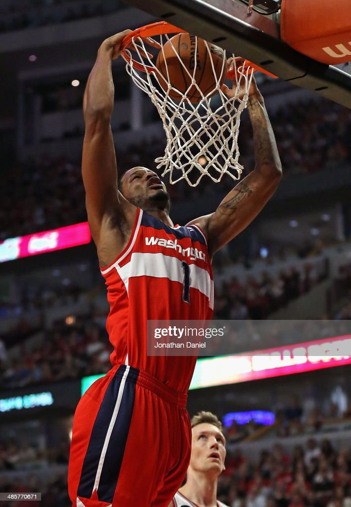 <a gi-track='captionPersonalityLinkClicked' href=/galleries/search?phrase=Trevor+Ariza&family=editorial&specificpeople=201708 ng-click='$event.stopPropagation()'>Trevor Ariza</a> #1 of the Washington Wizards dunks over Mike Dunleavy #34 of the Chicago Bulls in Game One of the Eastern Conference Quarterfinals during the 2014 NBA Playoffs at the United Center on April 20, 2014 in Chicago, Illinois.