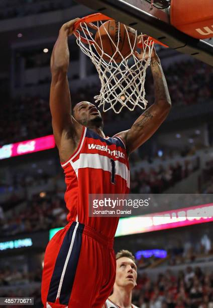 Trevor Ariza of the Washington Wizards dunks over Mike Dunleavy of the Chicago Bulls in Game One of the Eastern Conference Quarterfinals during the...