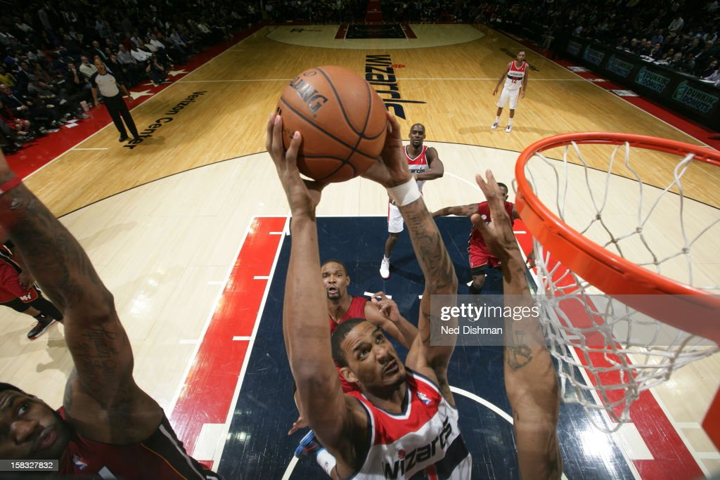 <a gi-track='captionPersonalityLinkClicked' href=/galleries/search?phrase=Trevor+Ariza&family=editorial&specificpeople=201708 ng-click='$event.stopPropagation()'>Trevor Ariza</a> #1 of the Washington Wizards dunks the ball against the Miami Heat at the Verizon Center on December 4, 2012 in Washington, DC.