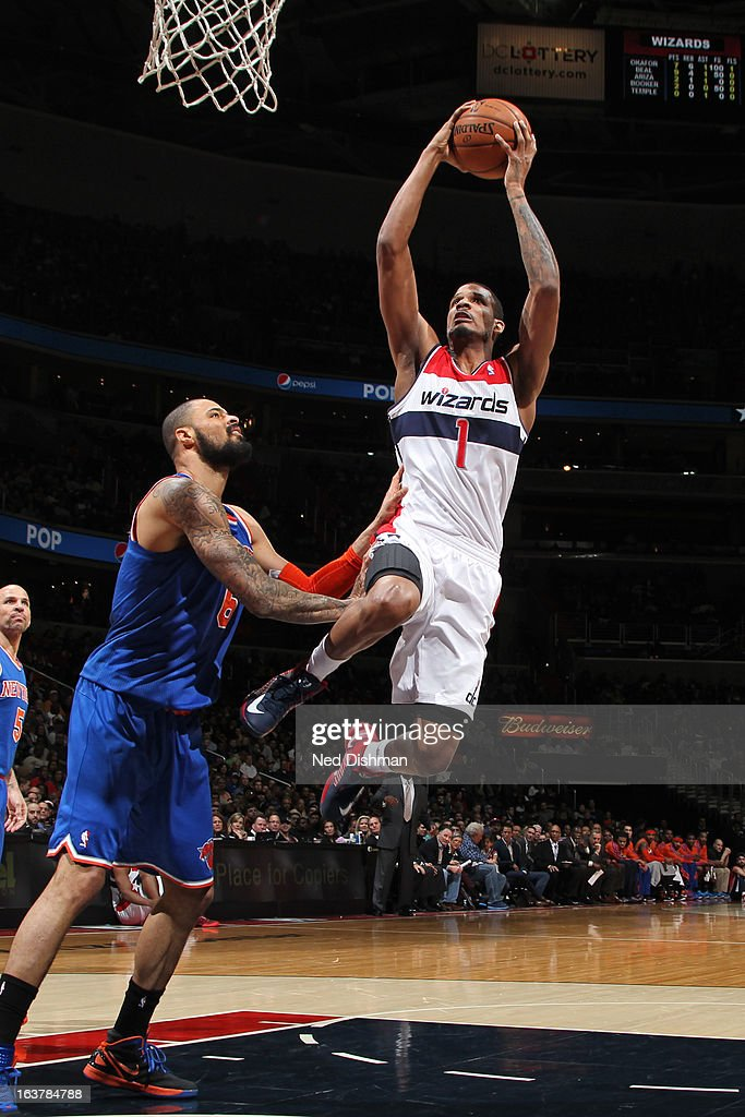 Trevor Ariza #1 of the Washington Wizards goes to the basket against Tyson Chandler #6 of the New York Knicks at the Verizon Center on March 1, 2013 in Washington, DC.