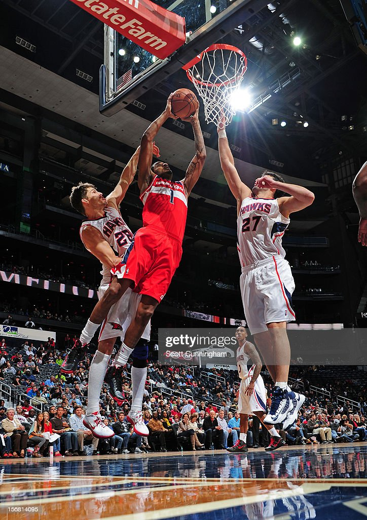 <a gi-track='captionPersonalityLinkClicked' href=/galleries/search?phrase=Trevor+Ariza&family=editorial&specificpeople=201708 ng-click='$event.stopPropagation()'>Trevor Ariza</a> #1 of the Washington Wizards goes up for the dunk vs the Atlanta Hawks at Philips Arena on November 21, 2012 in Atlanta, Georgia.