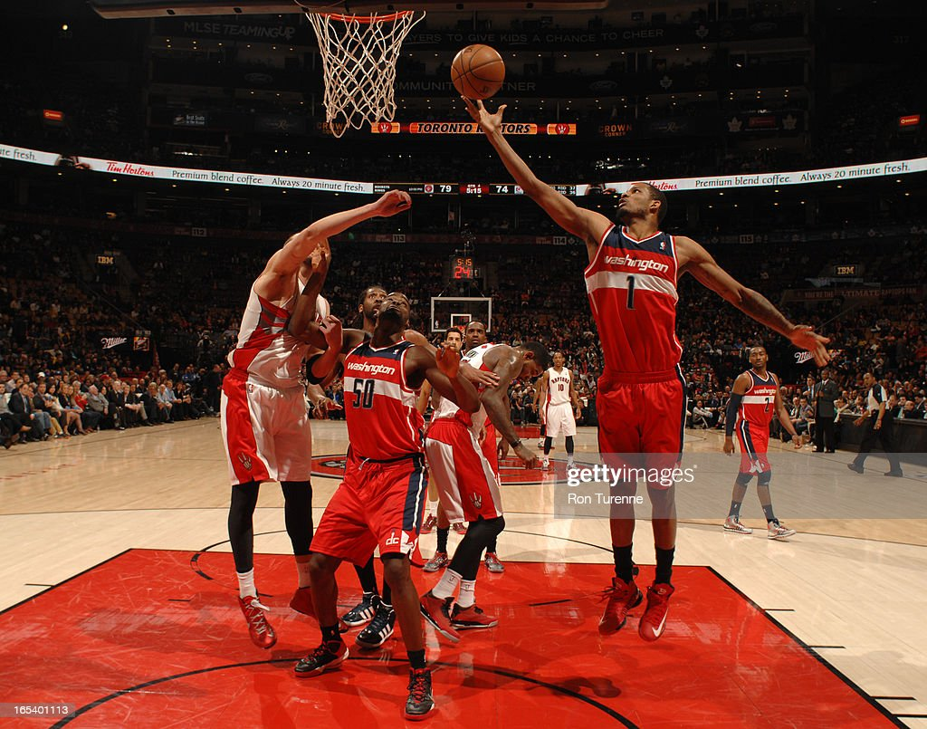 <a gi-track='captionPersonalityLinkClicked' href=/galleries/search?phrase=Trevor+Ariza&family=editorial&specificpeople=201708 ng-click='$event.stopPropagation()'>Trevor Ariza</a> #1 of the Washington Wizards goes up for the easy layup against the Toronto Raptors during the game on April 3, 2013 at the Air Canada Centre in Toronto, Ontario, Canada.