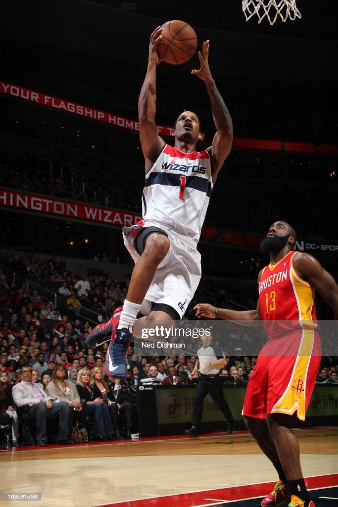 <a gi-track='captionPersonalityLinkClicked' href=/galleries/search?phrase=Trevor+Ariza&family=editorial&specificpeople=201708 ng-click='$event.stopPropagation()'>Trevor Ariza</a> #1 of the Washington Wizards goes up for the layup against the Houston Rockets during the game at the Verizon Center on February 23, 2013 in Washington, DC.