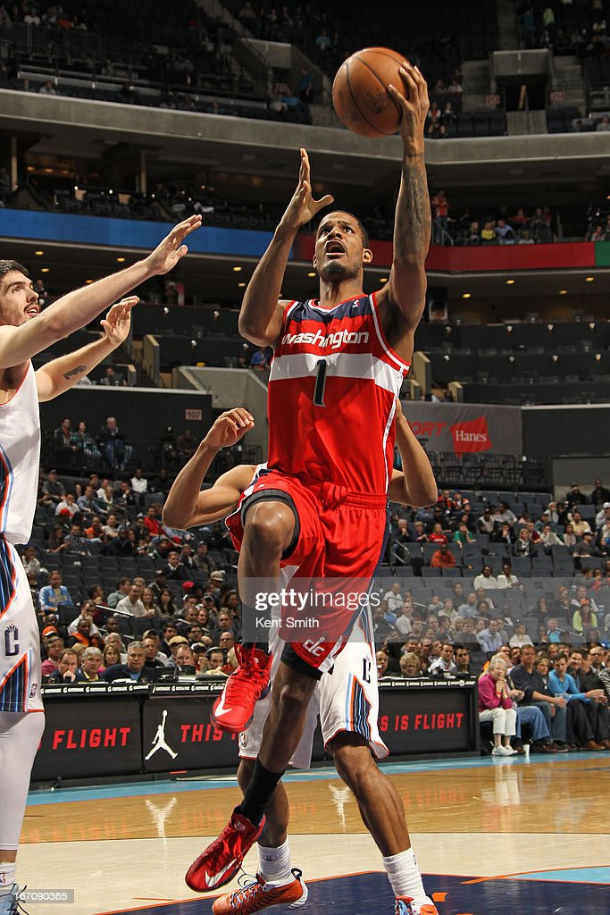 <a gi-track='captionPersonalityLinkClicked' href=/galleries/search?phrase=Trevor+Ariza&family=editorial&specificpeople=201708 ng-click='$event.stopPropagation()'>Trevor Ariza</a> #1 of the Washington Wizards goes up for the layup against the Charlotte Bobcats at the Time Warner Cable Arena on March 18, 2013 in Charlotte, North Carolina.